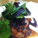 Grilled chicken chop in teriyaki sauce and greens