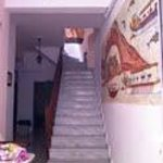 The staircase from first floor to basement