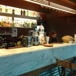 Bar area inside.  Many locals come here.  Note the traditional bowl of peanuts.