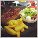 Nice juicy steak cooked to perfection home made chips and edible salad bowl