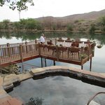 One of the pools and deck overlooking the river