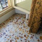 Fantastic floor tiles and gorgeous golden drapes