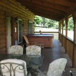 Huge Covered Porch with Plenty of Seating and Hot Tub