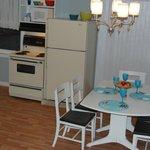Little White House.. open concept kitchen, dining, livingroom.