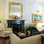Relax in the sitting room which has an orignal fireplace and high ceilings
