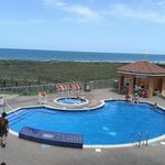 Pool area and walkway leading down to the beach