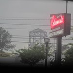 Rainy day and neon sign