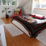 Our 'Attic Bedroom' features a very comfortable bed and a rustic ambience