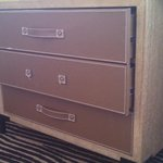 The dresser drawer, missing handle, won't close