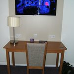 Large TV and desk area