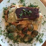 Creole tofu served with brussels sprouts and guajillo pepper grit cakes