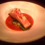 Poach salmon with a fresh rich tomato sauce