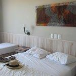 Cama de solteiro e cama de casal da suíte luxo