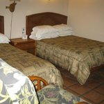 Comfortable beds, tiled floors