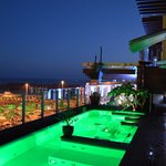rooftop swimming pool lights at night
