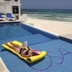 infinity pool and beautiful white sand beach