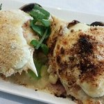 Crab topped with bechamel crumbed with tomato, olives, capers, & parmesan
