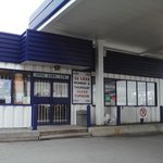 The Greco Xpress sign in the window of the convenience store