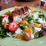 Fruit Tossed Salad with Grilled Brie Wedge - Delish!