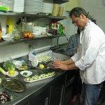 Pieter preparing the food during the seasonal food presentation