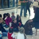Cowboy Steve tells Cowboy Christmas stories during the Schieleville Christmas celebration