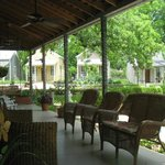 Front porch of restaurant/check-in building with four cottages in background