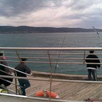 Fishing is popular at the end of the Lorne pier