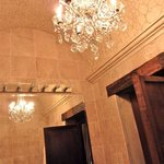 Remarkable details in the bathroom, from a chandelier, to an arched ceiling.
