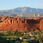 A view of downtown St. George with Red Rock Cliffs and Pine Mountain in background.