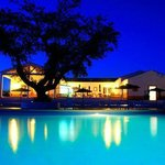 our wonderful swimming-pool at night and Clubhouse