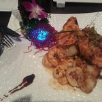 Their $35 seafood platter (shrimp/scallops/lobster) has a glowing blue light