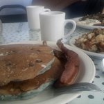 Blueberry pancakes with bacon and home fries, YUM!