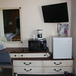 Room #6 Dresser drawers, mini-fridge, TV, microwave, coffee pot