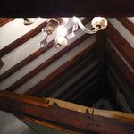 The other queen bed is upstairs in the open attic.