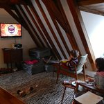 The kids watching TV in the living area.