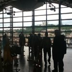 Visitors admiring the view from the glass roof