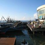 Fishing boats docked next to the market