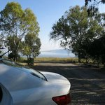 our rental car parked, Sea of  Galilee in distance