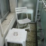 small balcony on single room faced alley