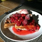 First breakfast: waffles with raspberry syrup and strawberry ice cream!
