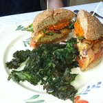 Tempeh Sausage Burger with kale side