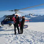 Our family in with the helicopter behind us - glorious snow capped peaks around us