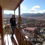 a happy gringa having a nice cup of coca tea with the view