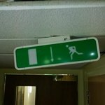 emergency exit sign in hallway