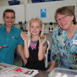 Staff and Volunteers having fun creating colourful marine creatures with visitors