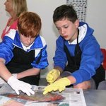 Local students doing a fish dissection