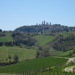 A view from the terrace with the towers of San Gimignano on the hill