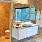 Stone bathroom with shower temple