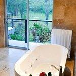 Stone bathroom with spa bath