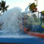 Surviving the watery onslaught of the big pineapple bucket in the SPLASH park